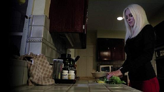 Diana cutting lettuce.