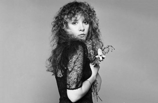 image of Stevie Nicks holding a flower