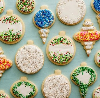 an array of cookies decorated as different Christmas onrmanents